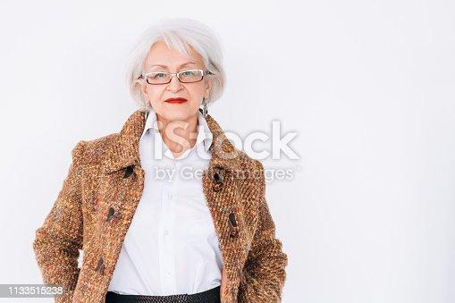 1133515238 istock photo senior woman fashion stylist elegance copy space 1133515238