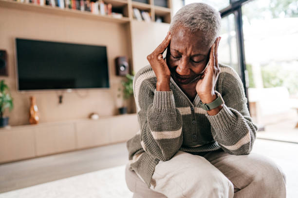 Senior woman feeling discomfort and weakness stock photo