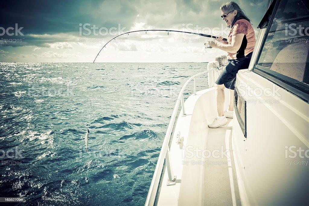 Senior woman fishing royalty-free stock photo
