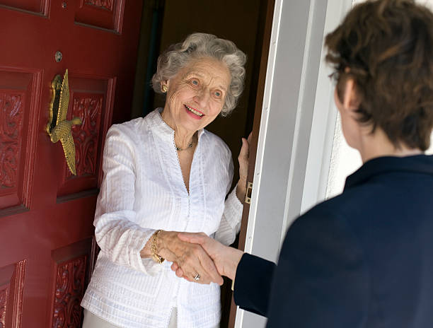Senior woman friendly handshake stock photo