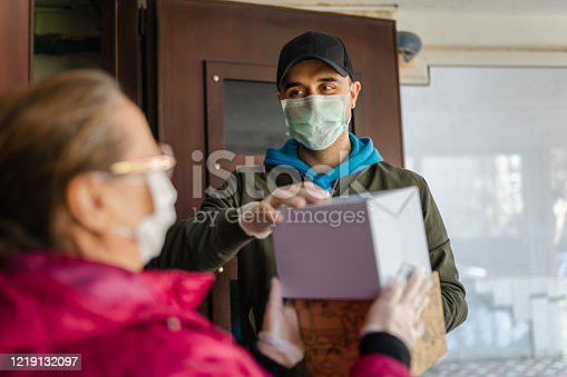 Senior woman getting a package from delivery person