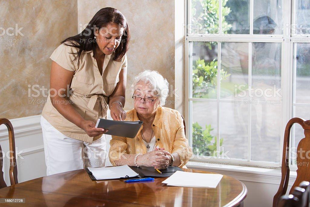 Senior woman getting advice stock photo