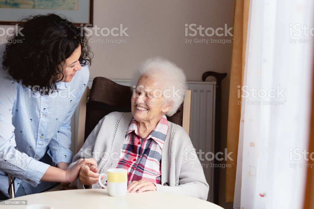 Senior woman getting care and assistance royalty-free stock photo