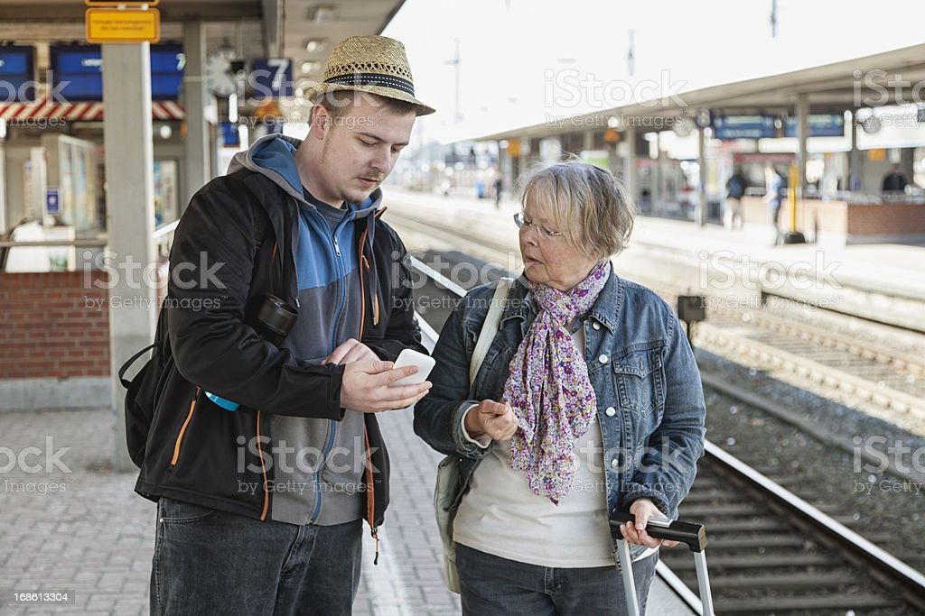 senior woman getting  help from young man royalty-free stock photo