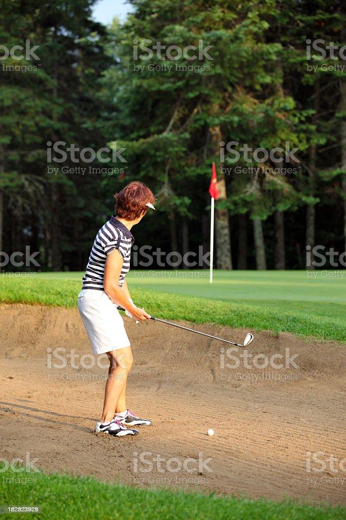 Senior Woman Golf Player Playing Bunker Shots royalty-free stock photo