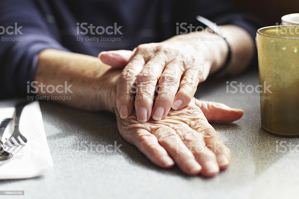 Senior Woman Hands on Restaurant Table royalty-free stock photo