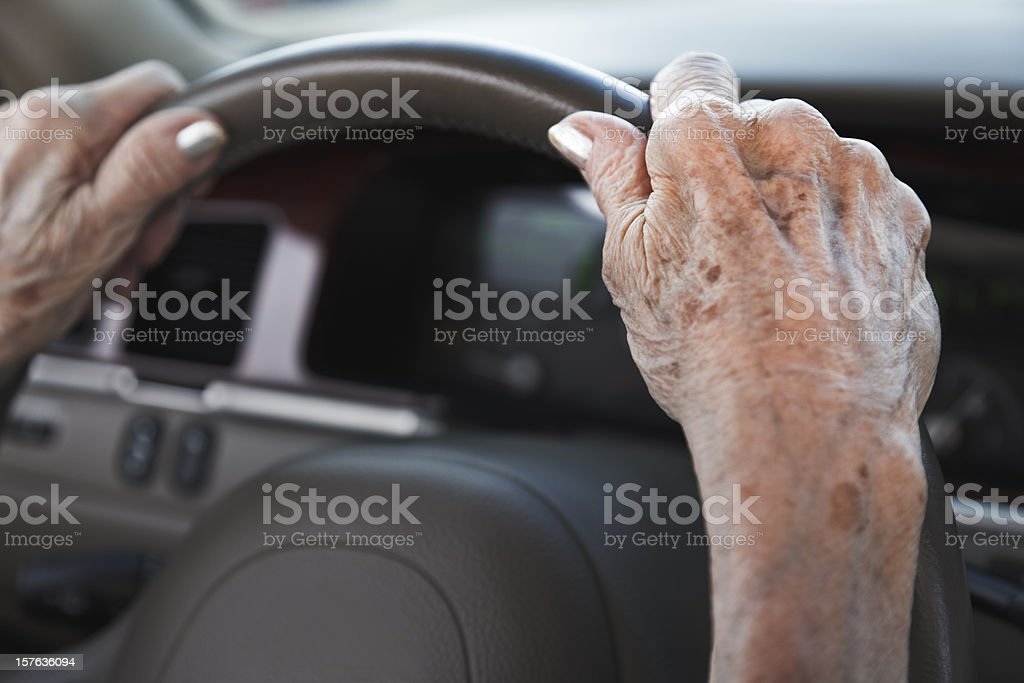 senior woman hands on steering wheel royalty-free stock photo