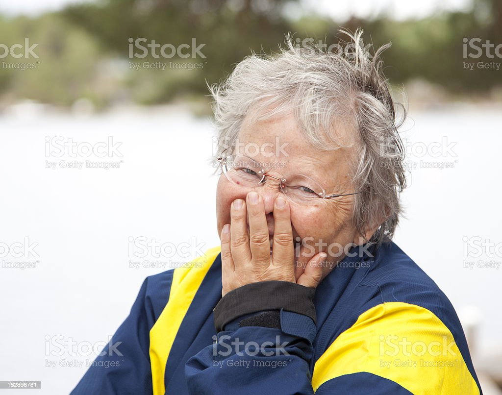 Senior woman having a good laugh. Outdoors. stock photo