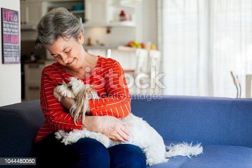 senior woman having fun with her dog