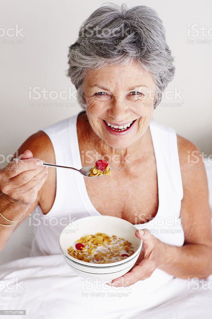 Senior woman having morning breakfast royalty-free stock photo