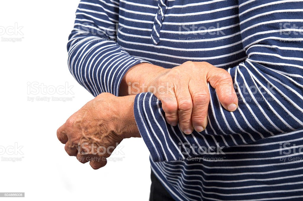 Senior woman having pain in left arm stock photo