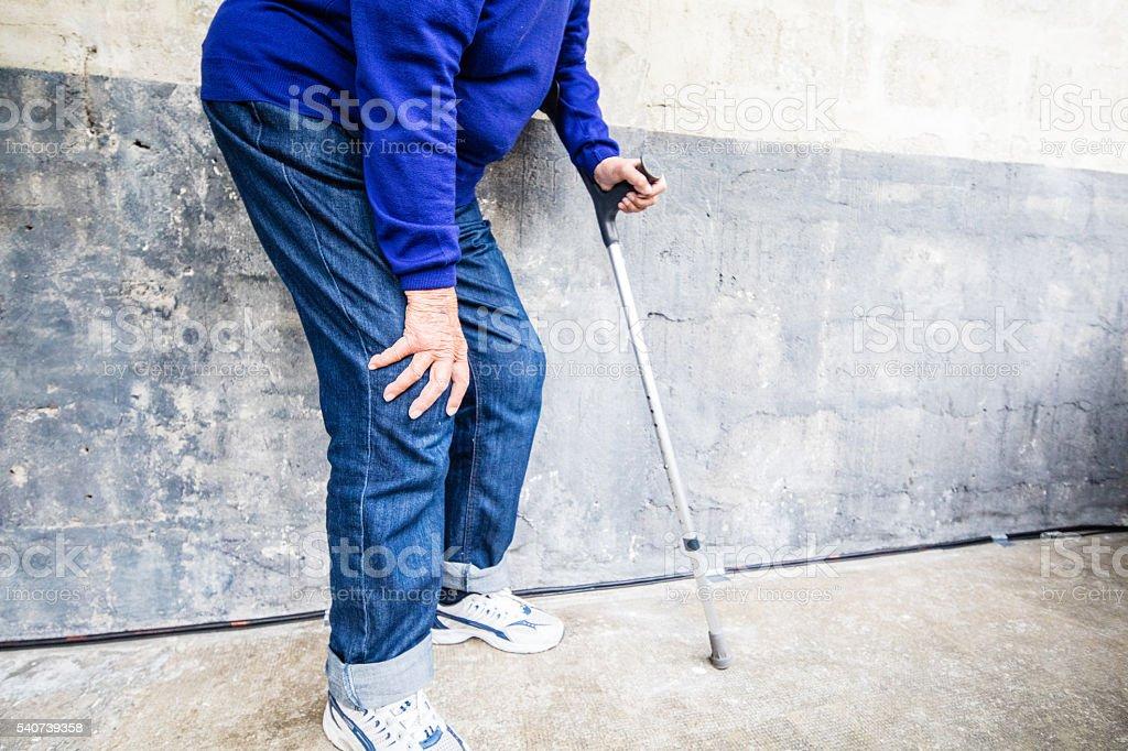 Senior woman having severe knee pain stock photo