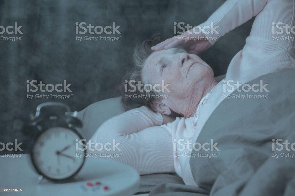 Senior woman having sleep disorder stock photo