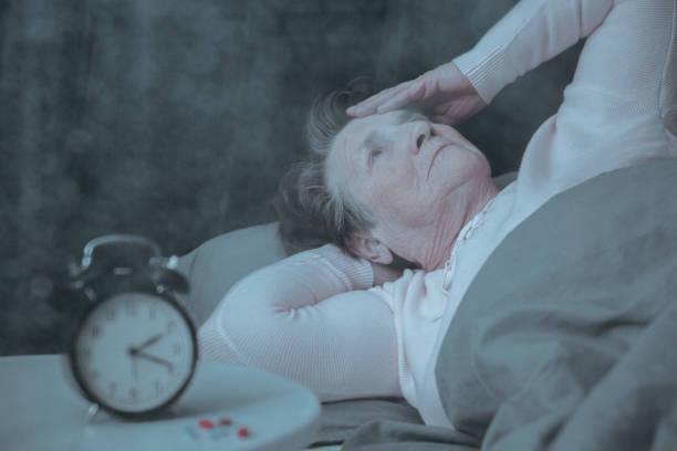 senior woman having sleep disorder - sleeping pill stock photos and pictures