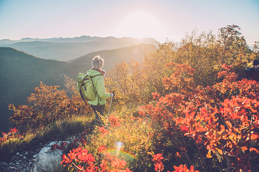 Senior Woman Hiking at Autumnal Dawn in Southern Julian Alps, Europe