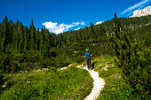 istock Senior woman hiking from the valley of the Seven lakes to Komna,  Slovenia 1268476396