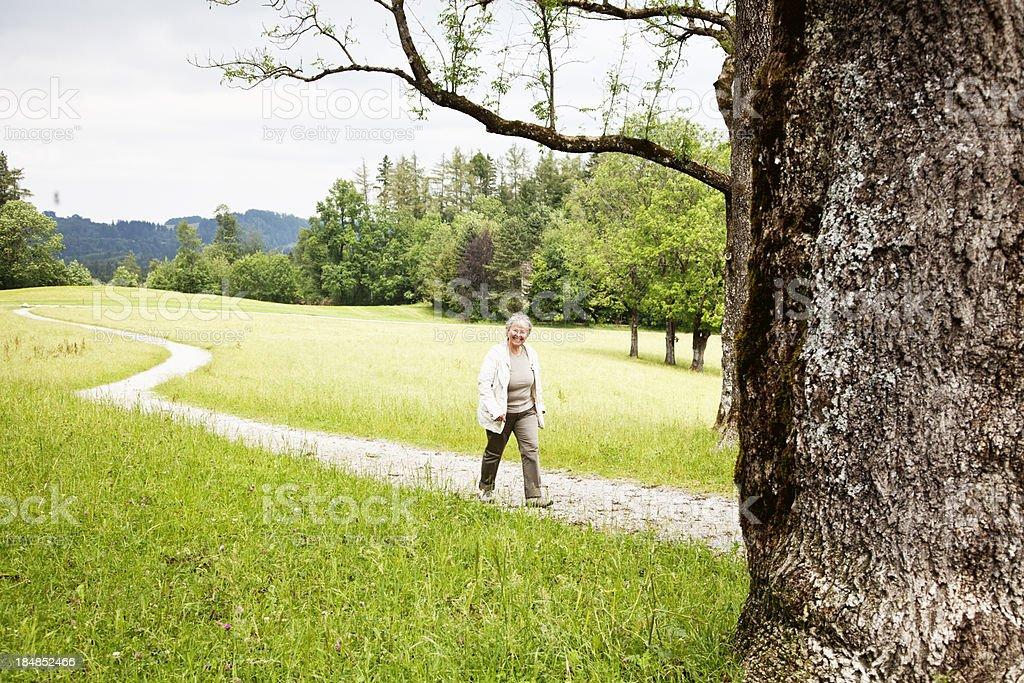 senior woman hiking royalty-free stock photo