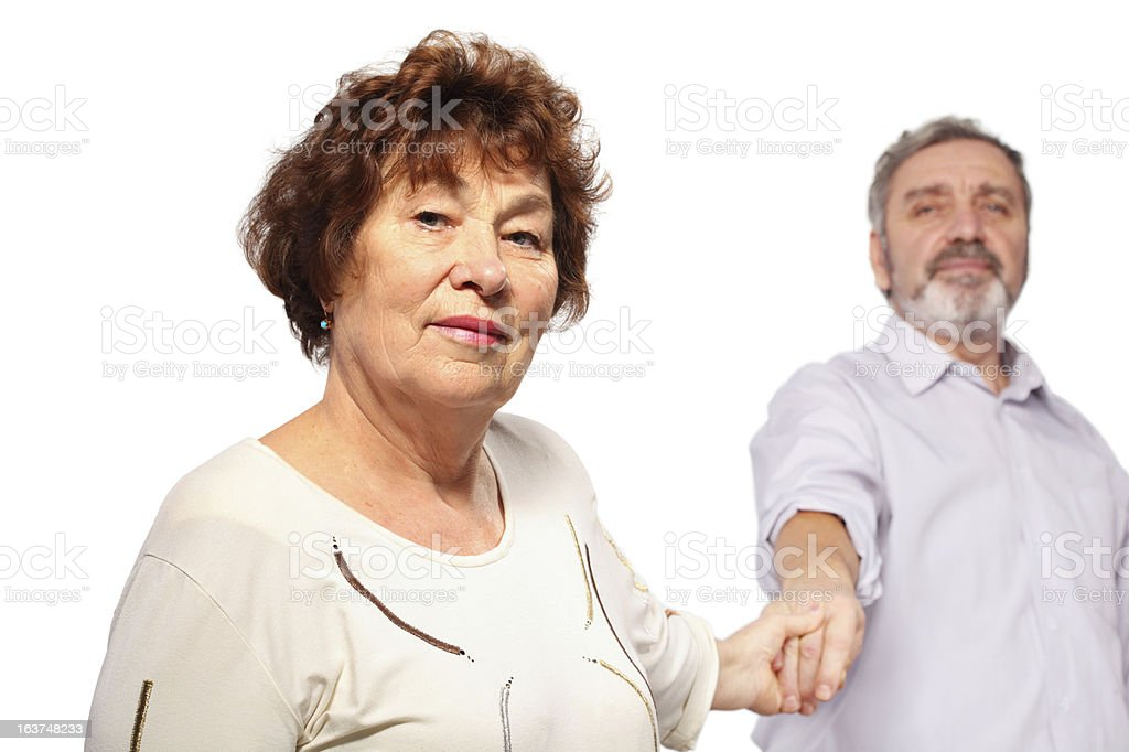 Senior woman hold hand of man royalty-free stock photo