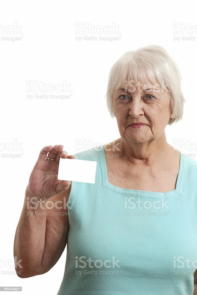 Senior woman holding a business card royalty-free stock photo