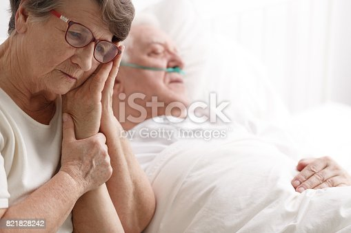 909569706istockphoto Senior woman holding her husband's hand 821828242