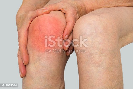 698466046istockphoto Senior woman holding the knee with pain 641929044