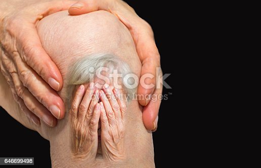 istock Senior woman holding the knee with pain 646699498