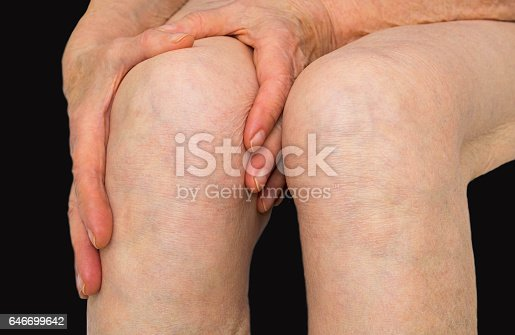 istock Senior woman holding the knee with pain 646699642