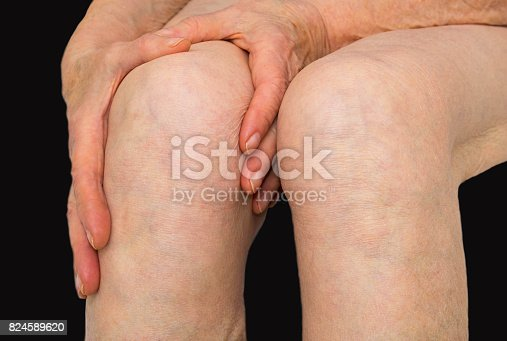istock Senior woman holding the knee with pain 824589620
