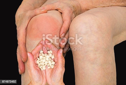 698466046istockphoto Senior woman holding the knee with pain 874973452