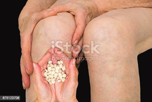 875123630 istock photo Senior woman holding the knee with pain 875123708