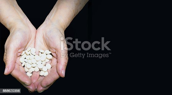 698466046 istock photo Senior woman holding the knee with pain 888620356