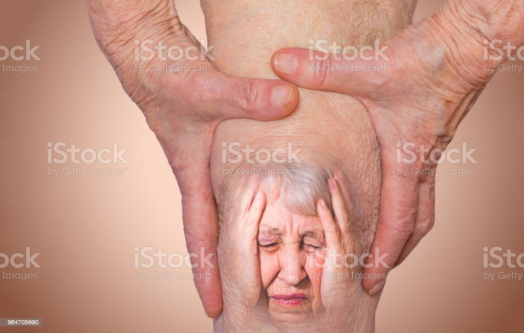 Senior woman holding the knee with pain royalty-free stock photo