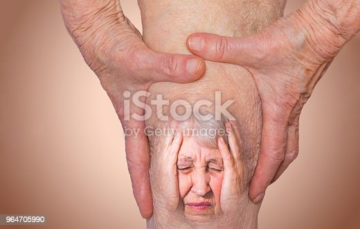 istock Senior woman holding the knee with pain 964705990