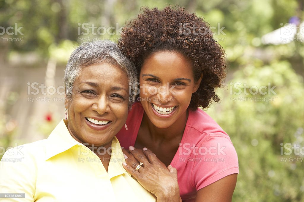 Senior Woman Hugging Adult Daughter stock photo