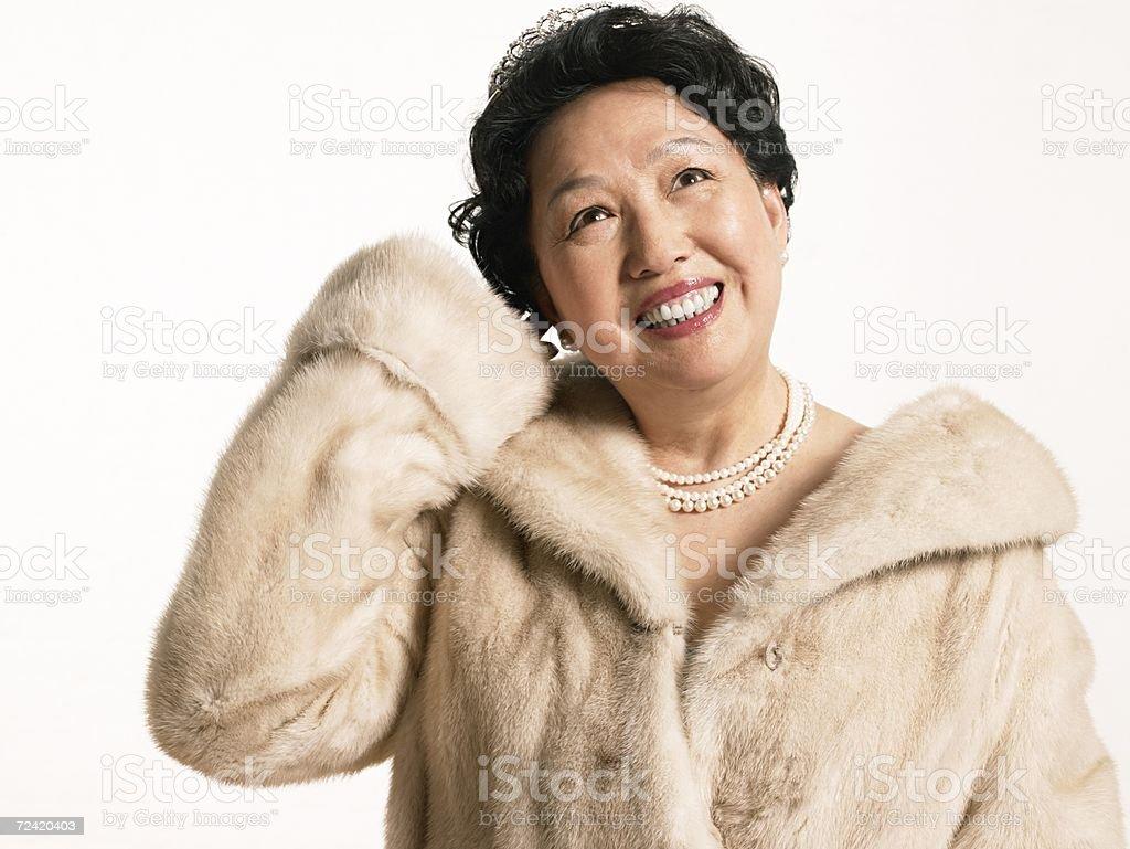 Senior woman in a fur coat royalty-free stock photo