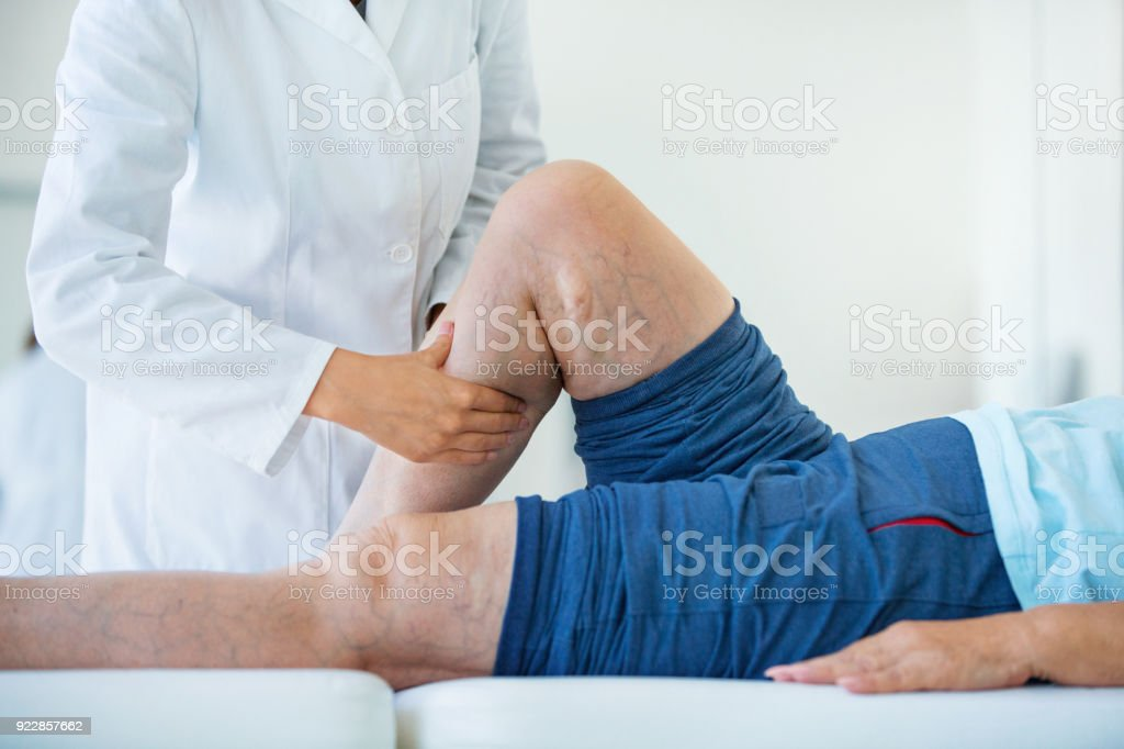 Senior woman in a massage treatment. stock photo