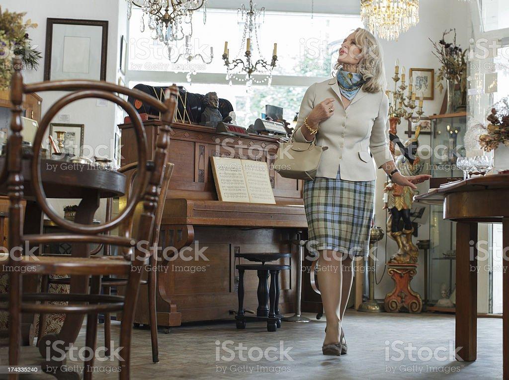Senior Woman in Antique Shop stock photo