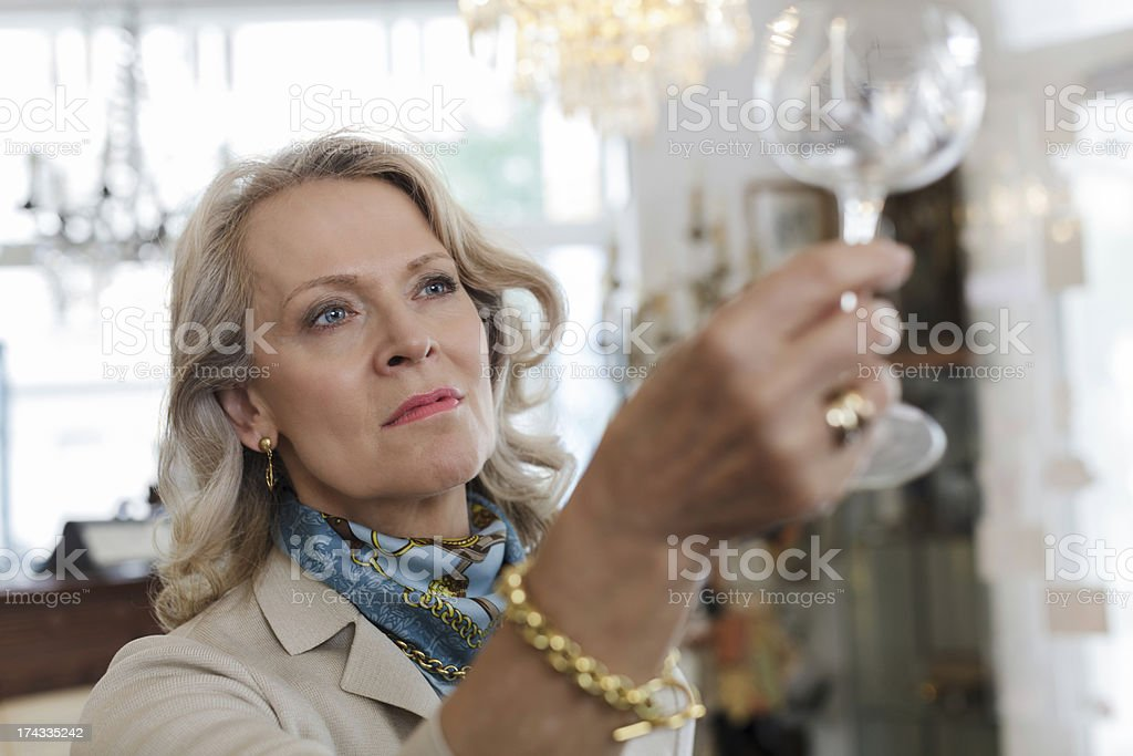 Senior Woman in Antique Shop stock photo