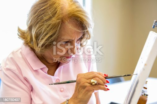 istock Senior woman in art class 180750407