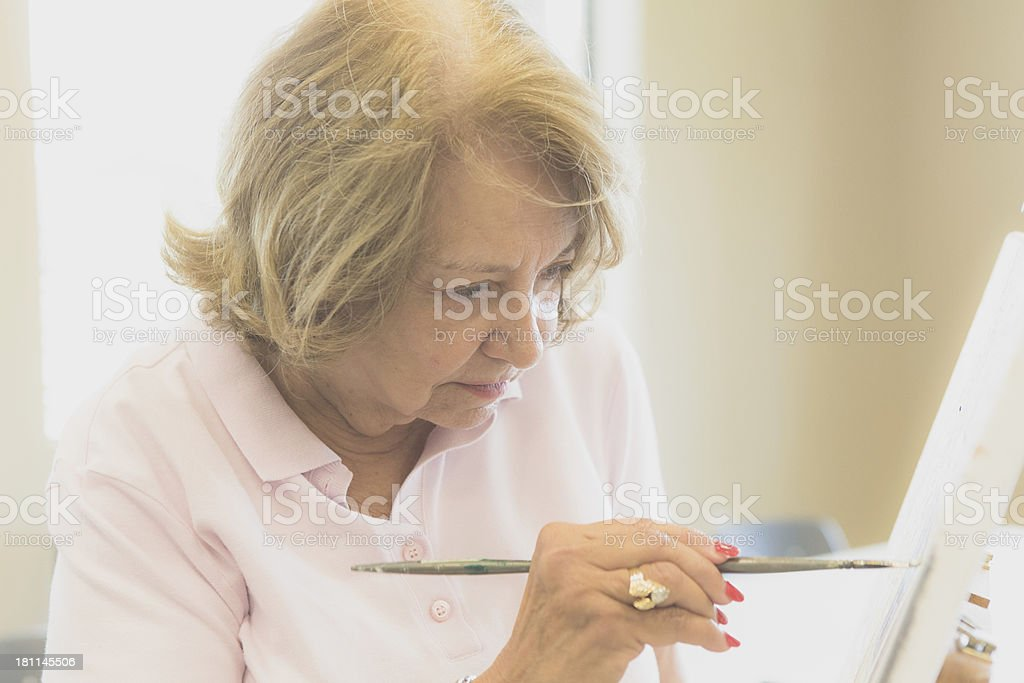 Senior woman in art class royalty-free stock photo