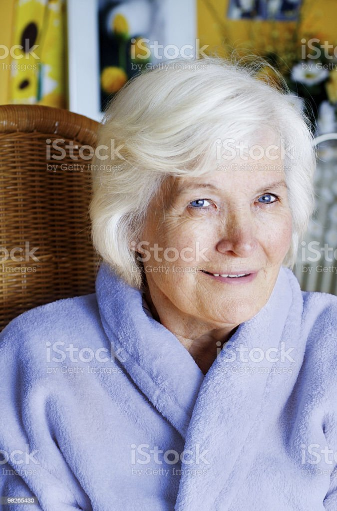Senior woman in bathrobe royalty-free stock photo