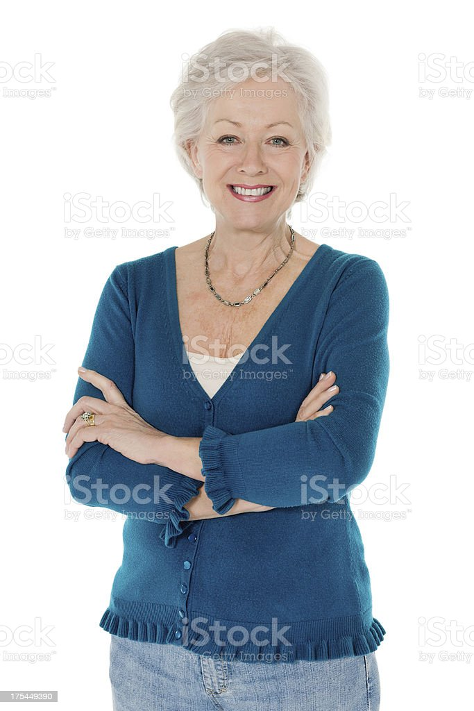 Senior Woman In Casual Wear Standing Arms Crossed stock photo