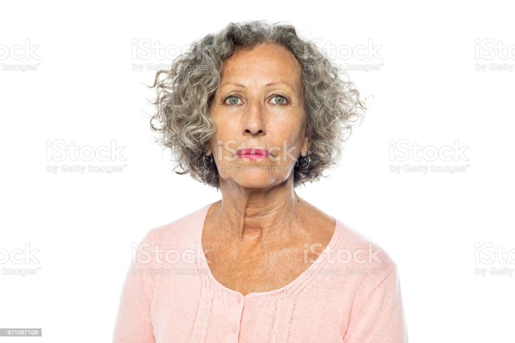 Senior woman in casuals looking serious stock photo