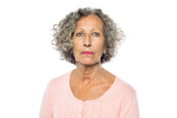 Senior woman in casuals looking serious Portrait of senior woman in casuals looking serious against white background. Caucasian woman with short grey hair. 60 64 years stock pictures, royalty-free photos & images