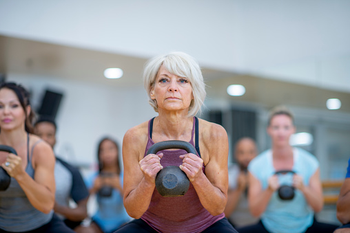 Senior Woman In Fitness Class Using A Kettlebell Stock Photo Stock Photo -  Download Image Now - iStock
