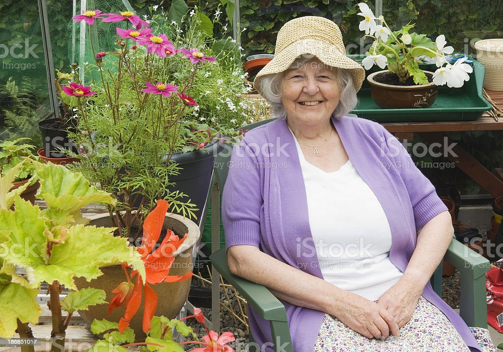 Senior woman in greenhouse royalty-free stock photo