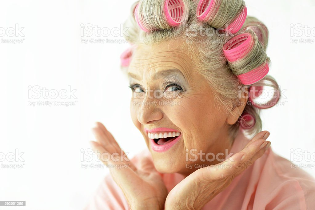 Senior woman in  hair rollers - Photo