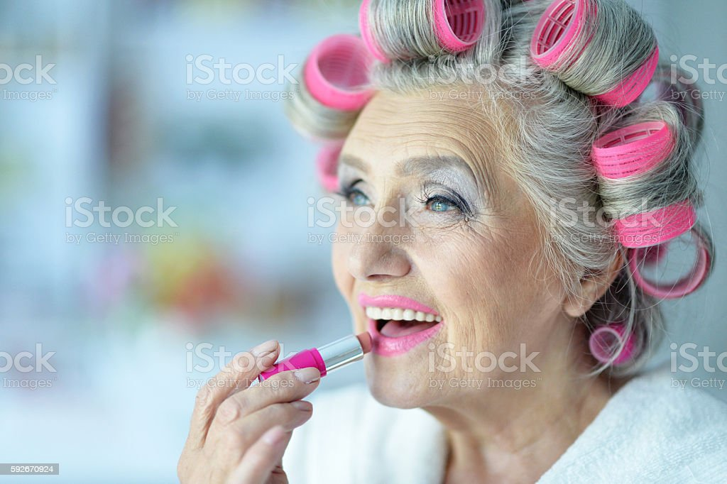 Senior woman in  hair rollers stock photo