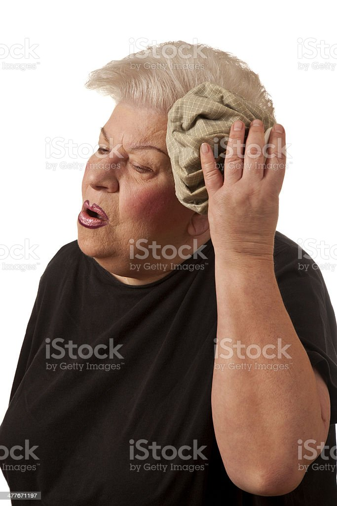 Senior woman in headache pain royalty-free stock photo