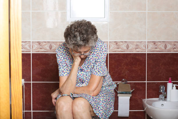 Senior woman in her bath room stock photo